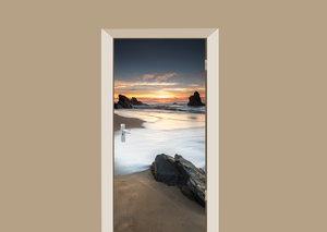 Deursticker zonsondergang op het strand
